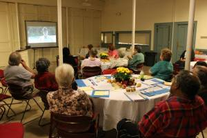 Worcester, MA - Voters watch video material on the four ballot questions